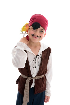 A young boy in pirate costume and holding a pet lovebird Stock Photo