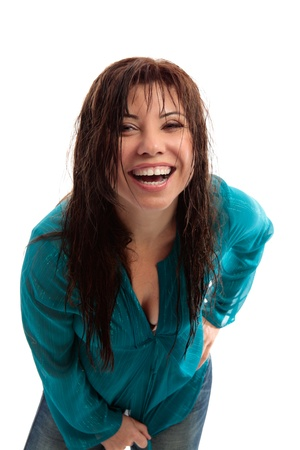 Vivacious fun loving exuberant brunette woman leaning forward and laughing hysterically mouth open,  photo