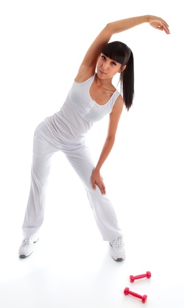 A beautiful young asiancaucasian girl standing and leaning over doing stretching toning exercises eg warm up, aerobic, pilates yoga, gymnastics, photo