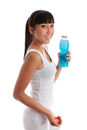 Fit healthy girl holding a bottle of drink after exercise or workout. Stock Photo - 9158369