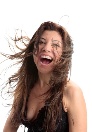 exuberant: Beautiful woman full of vitality and fun and laughter and zest for life.  Some parts of hair and mouth in motion. Stock Photo