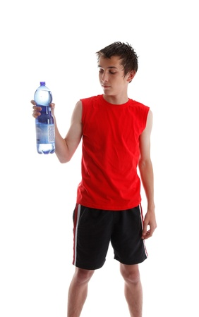 Teenager wearing gym clothes and holding a large bottle of water.  White background. Stock Photo - 9158399