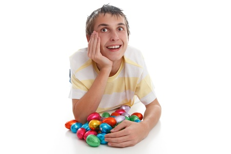 Boy lying down with easter eggs and looking up.  Space for text.  White background. Stock Photo - 9192471
