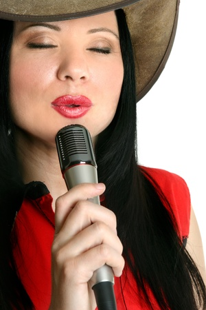 A country and western singer entertainer performing.  White background.