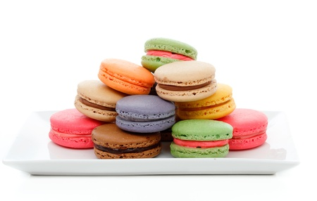 Delicious French macaroons in assorted colours on a serving dish. Stock Photo