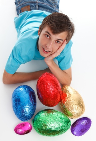 Smiling boy among a small selection of colourful easter eggs. Stock Photo - 9304730
