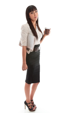 A young successful businesswoman wearing black skirt and striped blouse.   photo