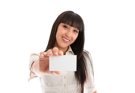 licence: A beautiful smiling young woman holding a businesscard, club card, id card, licence or other.  Blank.   White background.