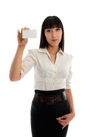 A young beautiful business office worker holds up a blank business card, club card or other type of card..  White background. photo