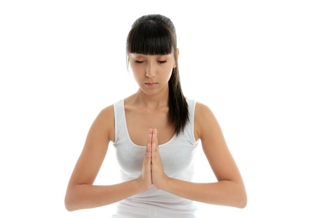 eastern philosophy: A young woman meditates  - holistic peace spirituality tranquility.
