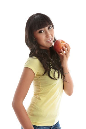A young pretty woman eating a healthy juicy apple.  White background. Stock Photo - 9964139