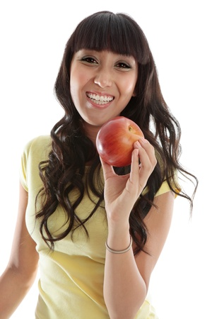 vivacious: A very happy vivacious young woman holding a delicious healthy fresh red apple.   Stock Photo