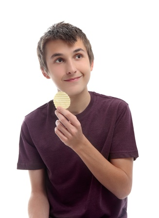 crisps: A boy holding a single potato crisp chip and looking sideways at your message.  White background.