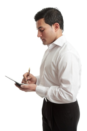 A businessman or waiter wriring in a notebook or taking an order.  White background. Stock Photo - 10048916