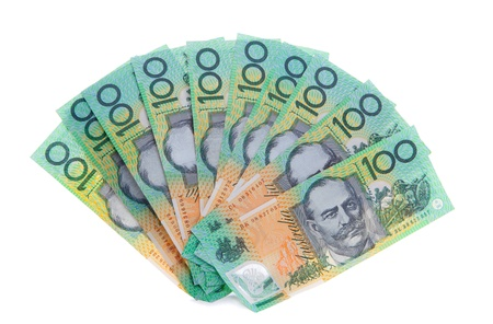 australian money: A fan of ten Australian one hundred 100 dollar note bills, cash, money totalling $1000. Australia was the first country to have an entire note currency made of plastic, which is extremely difficult to counterfeit. One side shown only Stock Photo