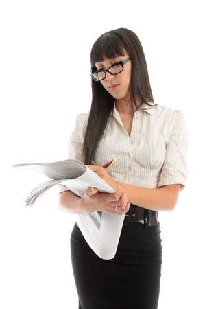 A businesswoman reading the financial newspaper or looking at the careers section Stock Photo