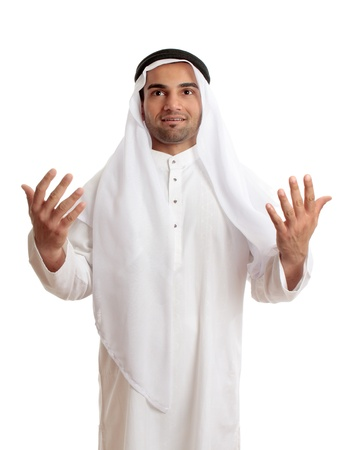 A happy arab middle eastern man with hands outstretched in praise and worship.  White background. Stock Photo