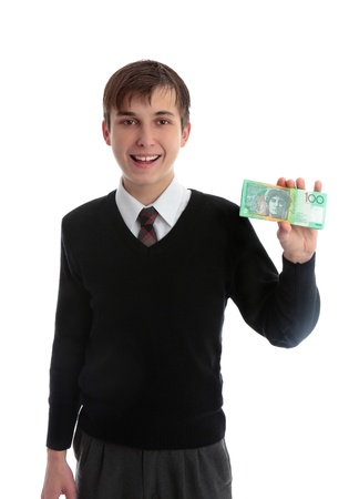 first job: Student schoolboy holding some bills in his hand and smiling.  Concept, school fees, fundraising, charity, first job, student loan.  Only showing 12 of the note, front side, back is different. White background.