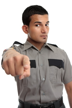warden: A security guard, prison officer or other similarly dressed occupation.  Man is pointing his finger  Stock Photo