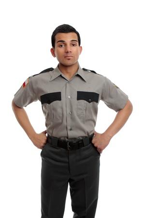 warden: Guardia de prisi�n, guardi�n o firma de CP de pie con las manos en la cadera Foto de archivo