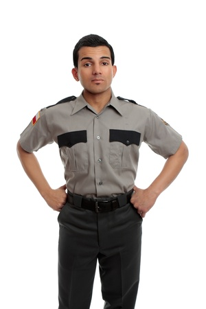 Prison guard, warden, or cop standing firm with hands on hip