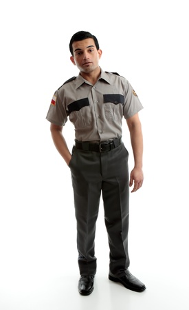 A male worker wearing uniform is standing with one hand in pocket on a white background