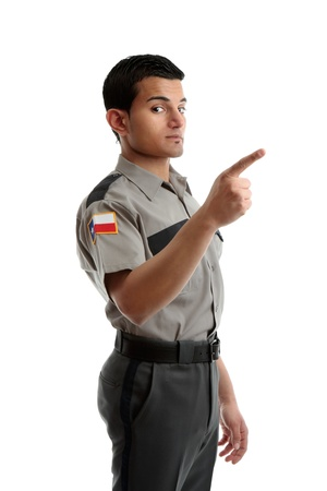 body guard: A security guard, prison warden or other uniformed man pointing his finger at your message.  White background.