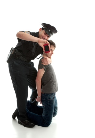 juvenile delinquent: Happy policeman after arresting a teen felon and recovering stolen item. Stock Photo