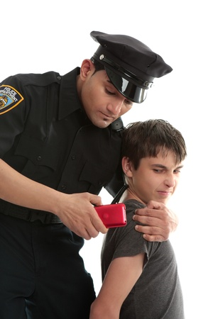 apprehend: A policeman with a male juvenile delinquent that has stolen an electronic device. item