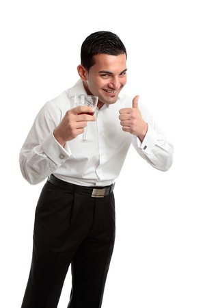 A happy, laughing and optimistic man holding a glass of red wine and showing thumbs up success or approval hand sign. Stock Photo - 10438931