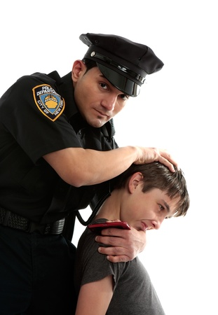 juvenile delinquent: A policeman apprehends a male teen thief.  White background.