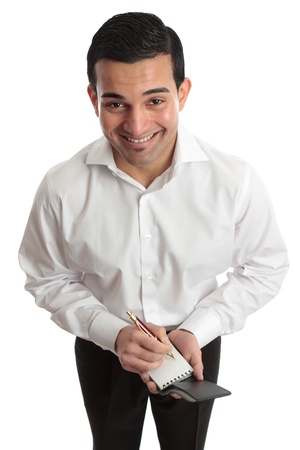 A very happy businessman, waiter, student or other occupation, holding a handheld notepad and pen.   Stock Photo
