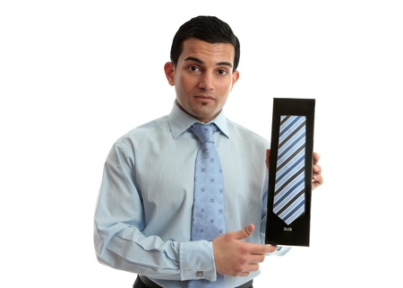 menswear: Salesman or businessman holding a tie - or can be other object.