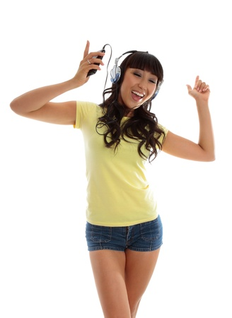 A vivacious active young woman dancing and listening to music photo