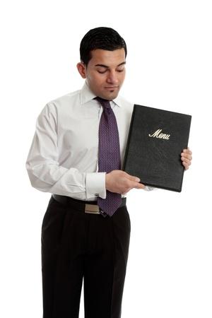 A professional businessman, waiter, restauranteur holding and presenting a black leatherbound folder. photo
