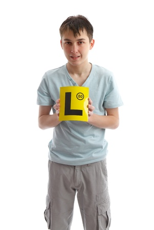 l first: Teenage boy holding L plates (or other sign).  White background.