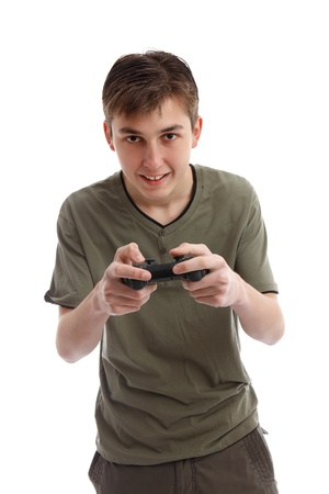 Happy teen boy playing a computer game using a wireless console.  White background, photo