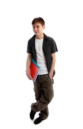 Ein High-School-oder College-Student steht in Freizeitkleidung und Durchführung einige Bücher unter einem arn. Weißer Hintergrund. Standard-Bild