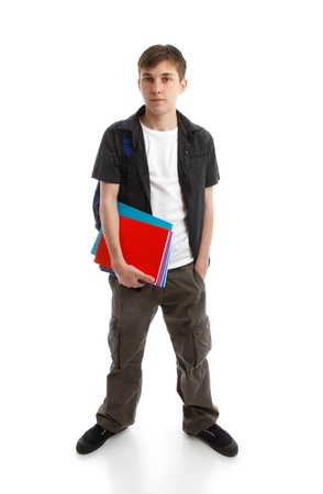secondary education: A teenage student standing with hand in pocket.  He is carrying a backpack and some books.  White background.