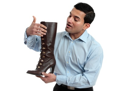 italian ethnicity: A store salesman showing a womens leather lace up boot.  White background. Stock Photo