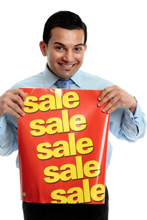 A male salesman holding a sale sign and smiling. photo