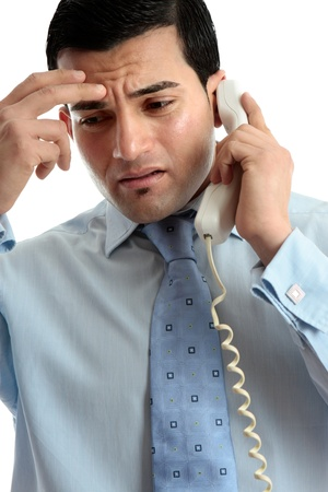 upset man: Stressed, depressed, worried or upset business man using telephone.  Useful for many situations.  White background.