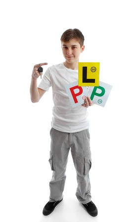 learner: Full length teenager.  He is holding a car key and various licence plate signs for learner drivers.  White background.