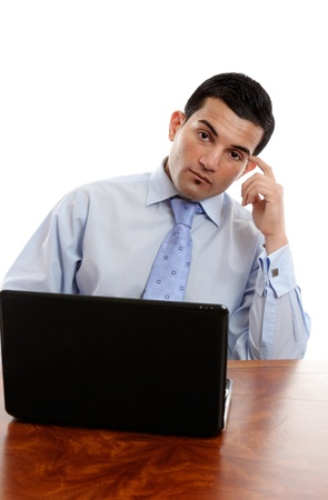 A businessman sitting at office desk and thinking photo