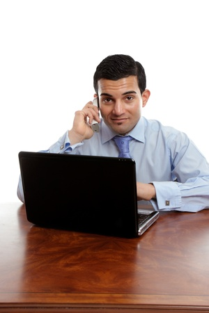 walnut burl: A sincere businessman taking a phone call while at work Stock Photo