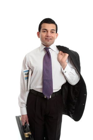 Confident businessman holding a briefcase in one hand, newspaper underarm and suit jacket slung over other  shoulder Stock Photo - 13605918