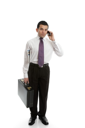 A businessman carrying a black briefcase and using a mobile cell phone. Stock Photo - 13687854