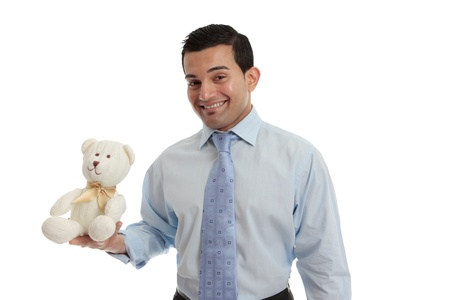 Man holding a hand knitted teddy bear in cream wool and tied with a pretty gold ribbon.  White background. Stock Photo - 13755182