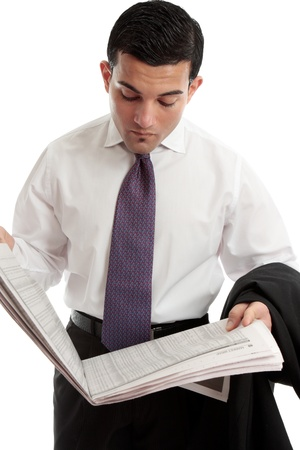 stockbroker: An investor, stockbroker or businessman reads the sharemarket pages of the financial newspaper Stock Photo