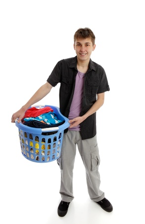 A teenage boy holding a basket of laundry.  White background. photo